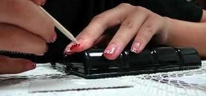 Create red French style nail tips with white polkadots