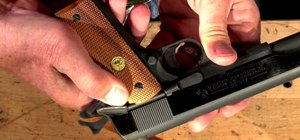 Use each of the three safety features on a Colt model 1911 series 80 handgun