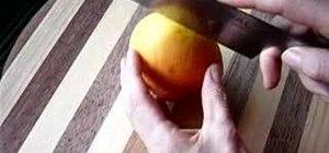 Cut the cheeks off a mango