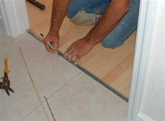 Tiling Bathroom Door Threshold how to install a t-mold transition between laminate & ceramic tile