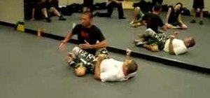 Do a Krav Maga release form the guard position