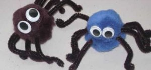 Make a pom-pom spider with your kids