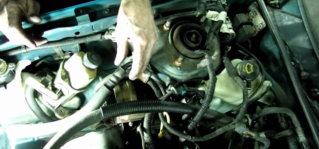 How To Replace The Water Pump And Timing Belt On A Ford Escort
