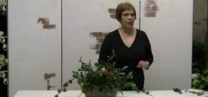 Make a dish garden arrangement using silk flowers