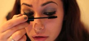Create a dazzling neutral eye and red lip New Year's Eve makeup look