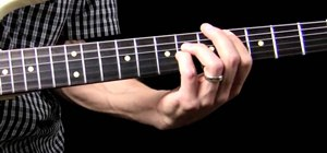 Play power chords with open strings on the guitar