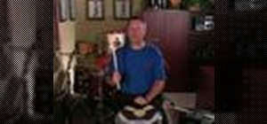 Play the upstroke drum rudiment