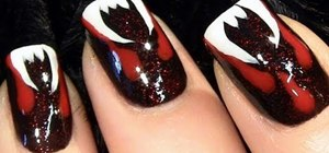 Create a bloody fang vampire nail look for Halloween