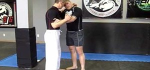 Use collar ties, elbow ties, and proper grip in MMA