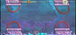 Defeat the boss Capamari in Water Land for Kirby's Epic Yarn