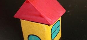 Make a fun block house out of wooden building blocks