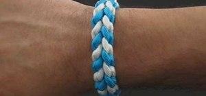 Tie a paracord river bar bracelet