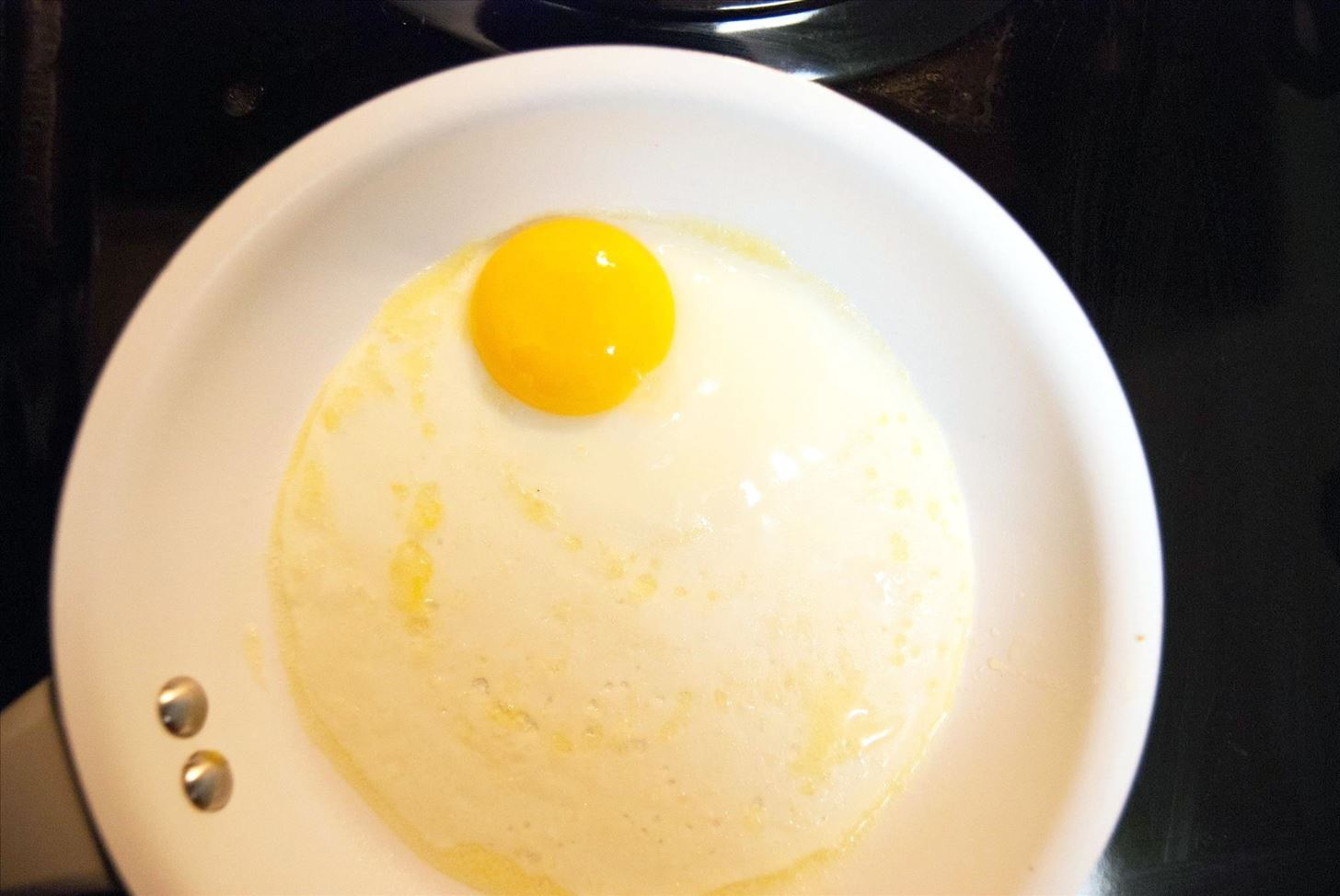 For Perfect Sunny-Side Up Eggs Every Time, Whisk Them (Seriously)