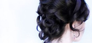 Create a sophisticated curly bridal updo for short hair