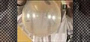 Makea coin spin inside a balloon