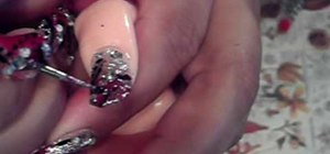 Paint your nails in a red, black, and silver art theme