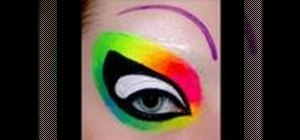Create rainbow warrior makeup around your eyes