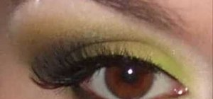 Apply bright green , brown and black eye shadow