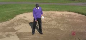Make a fairway bunker shot when playing golf