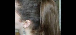 Style a Nicole Sherzinger voluminous flipped curly ponytail