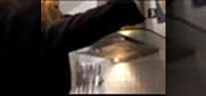 Clean a glass oven hood