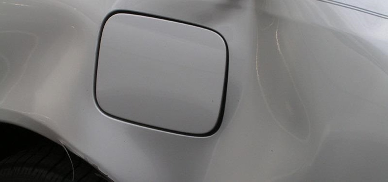 Fix a Huge Dent in Your Car at Home Without Ruining the Paint Job