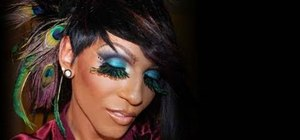 Create a colorful, rhinestone-studded peacock makeup look for Halloween
