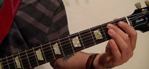 """Play Johnny Cash's """"I Walk The Line"""" intro on the acoustic guitar"""