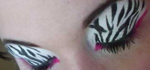 Apply zebra print with hot pink eye makeup