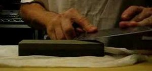 Sharpen a knife using a sharpening stone