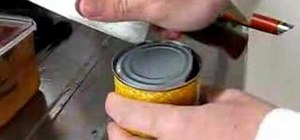 Open a can using a knife instead of a can opener