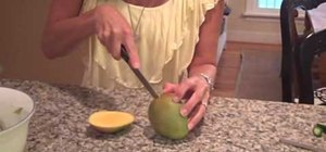 Cut a mango for mango salsa