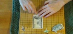Make an origami frog out of a dollar bill