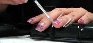 Apply a purple glitz French manicure