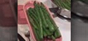 Cook asparagus, Cajun style, in a pan