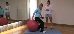 Get a flat stomach with a fitness ball workout