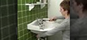 Remove a washer from a tap to stop leakage