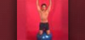 Exercise with kneeling dumbbell shoulder press on ball