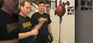 Practice boxing on a double end bag
