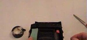 Load 35mm film in a Holga camera
