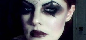 Create a dark Victorian Gothic circus girl makeup look for Halloween