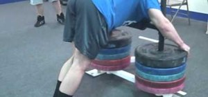 Do the Heavy A Prowler move to strengthen your legs and core