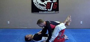 Counter an arm bar with a knee bar in Jiu Jitsu