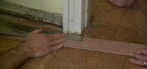 Cut a door jamb to install flooring