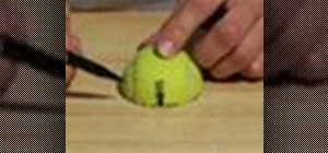 Make a mini tripod for your camera with a tennis ball