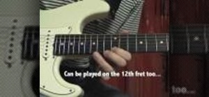 Play a slow pentatonic blues lick in E on the guitar