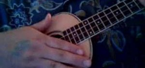 Play the triple strum pattern on the ukulele