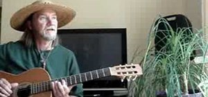 Play an E blues riff on the acoustic guitar