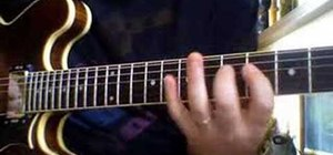 "Play ""YYZ"" by Rush on the electric guitar"