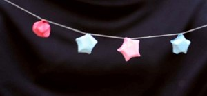 Make a Christmas garland out of recycled paper stars